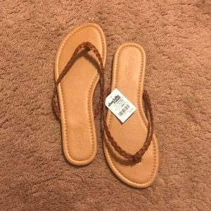 Braided tan leather flip flops